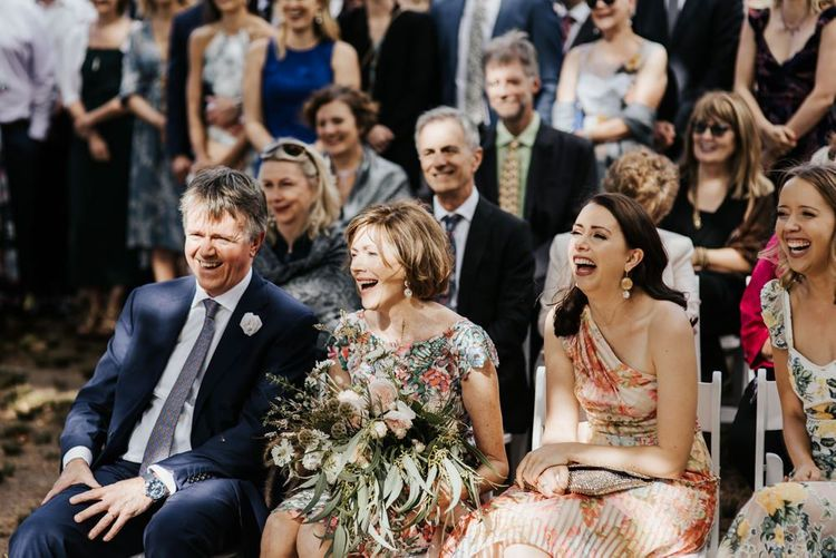 Wedding Guests Smiling and Laughing at the Outdoor Wedding Ceremony