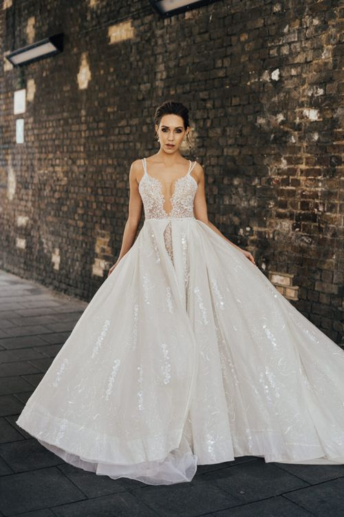 Bride in Spaghetti Strap Wedding Dress from Morgan Davies Bridal with Detachable Skirt