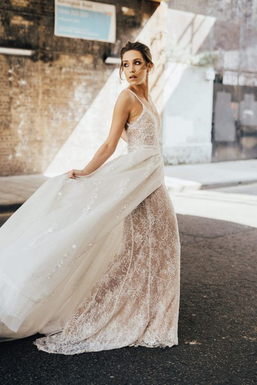 Bride in Fitted Lace Wedding Dress from Morgan Davies Bridal with Detachable Full Skirt