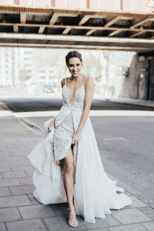 Bride in Fitted Lace Wedding Dress with Thin Straps from Morgan Davies Bridal with Detachable Full Skirt