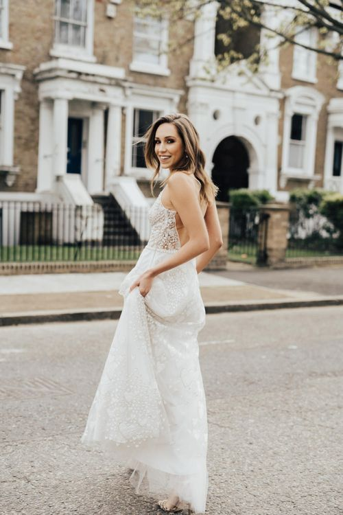 Bride in Heart Embroidered Wedding Dress From Morgan Davies Bridal Walking in the Urban Street