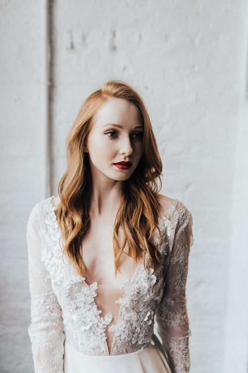 Bride in Long Sleeve Lace Wedding Dress from Morgan Davies Bridal with Red Lipstick