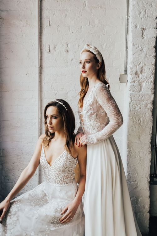 Two Brides in Long Sleeve Lace Bridal Gown with Spaghetti Strap and Heart Embroidered Wedding Dress from Morgan Davies Bridal