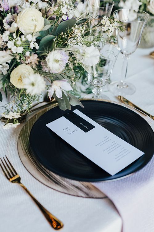 Monochrome Place Setting with Black Tableware, Gold Cutlery and Lilac and White Feminine Florals
