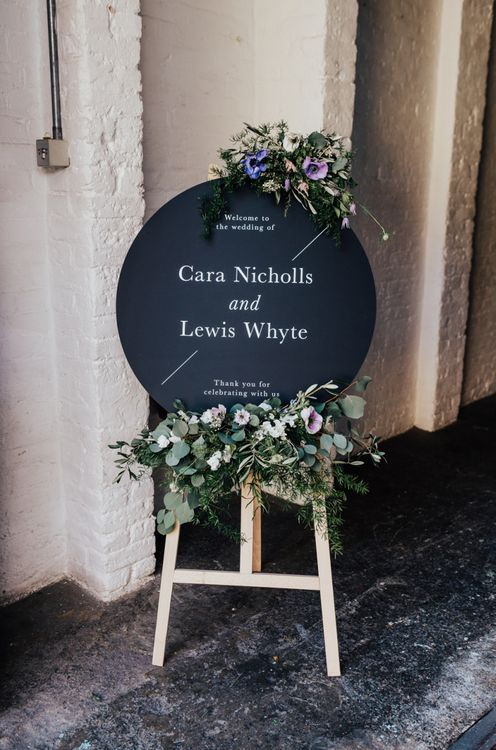 Round Wedding Welcome sign on Wood Easel with Lilac and White Feminine Flowers
