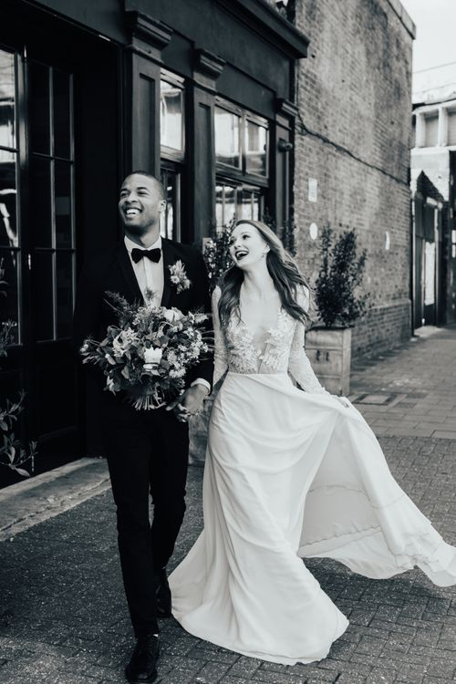 Laughing Bride in Lace Long Sleeve Wedding Dress from Morgan Davies Bridal with Groom in Black Tuxedo & Bow Tie