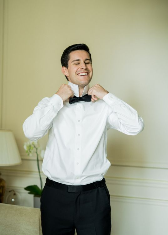 Groom Getting Ready into His Back Tie Suit