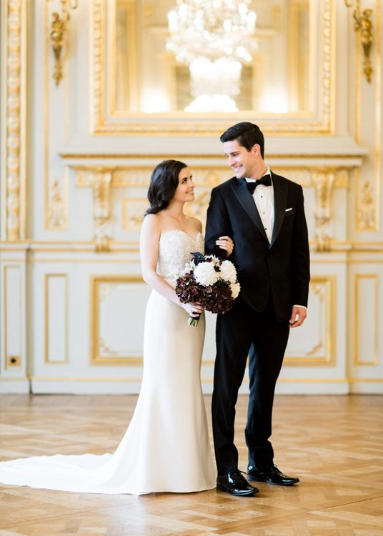 Bride in Sweetheart Neckline Tara Keely Wedding Dress and Groom in Black Tuxedo Arm in Arm