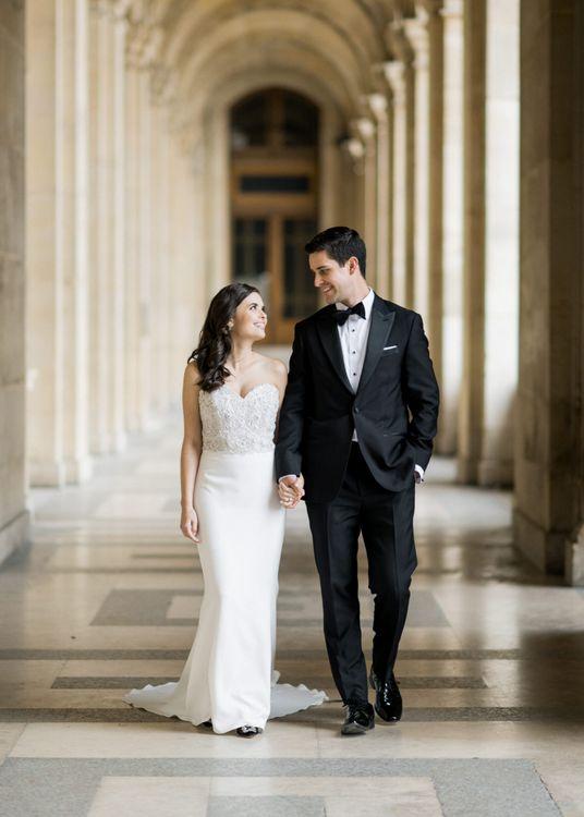 Bride in Tara Keely Wedding Dress and Groom in Black Tie Suit Walking Hand in Hand