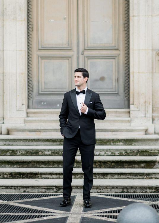 Soave Groom in Black Tie Wedding Suit