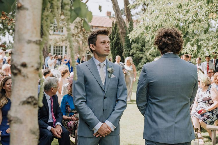 Groom at the Outdoor Altar in Grey Moss Bros Suit   Wedding Weekend at West Lexham Manor, Norfolk   Megan Duffield Photography