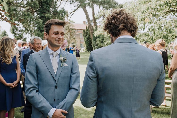 Groom at the Altar in Grey Moss Bros Suit   Wedding Weekend at West Lexham Manor, Norfolk   Megan Duffield Photography