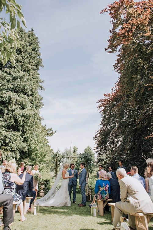 Outdoor Wedding Ceremony   Bride in Mori Lee Wedding Dress   Groom in Light Grey Moss Bros Suit   Wedding Weekend at West Lexham Manor, Norfolk   Megan Duffield Photography