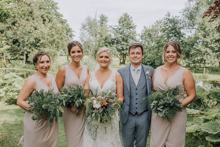 Bridesmaids in Blush Pink TFNC Dresses   Bride in Lace Mori Lee Wedding Dress   Groom in Light Grey Moss Bros Suit   Wedding Weekend at West Lexham Manor, Norfolk   Megan Duffield Photography