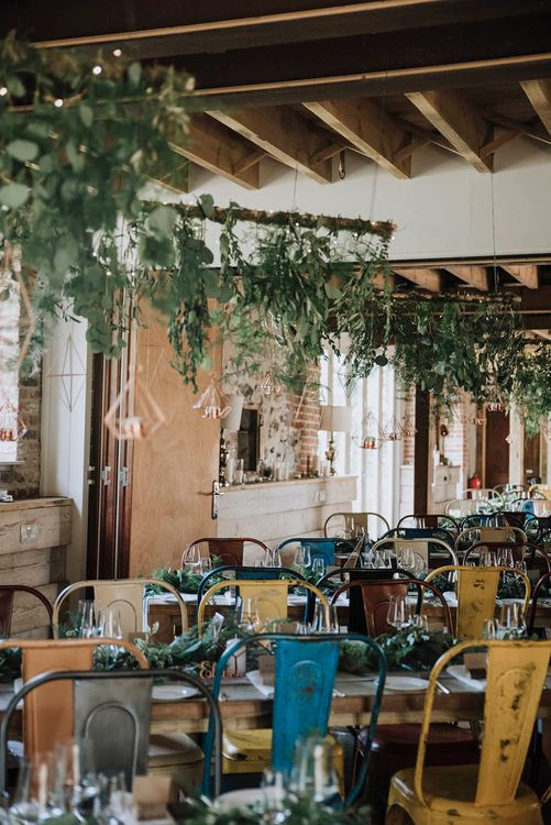 Wedding Reception Decor   Hanging Greenery  Installation   Industrial Chairs   Wedding Weekend at West Lexham Manor, Norfolk   Megan Duffield Photography
