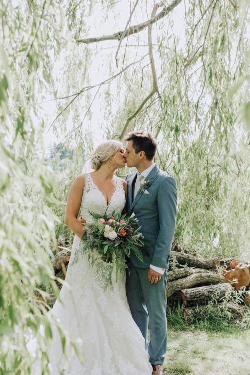Bride in Mori Lee Wedding Dress   Groom in Light Grey Moss Bros Suit   Wedding Weekend at West Lexham Manor, Norfolk   Megan Duffield Photography