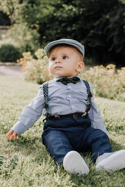 Toddler in Braces, Bow Tie & Flat Cap   Wedding Weekend at West Lexham Manor, Norfolk   Megan Duffield Photography