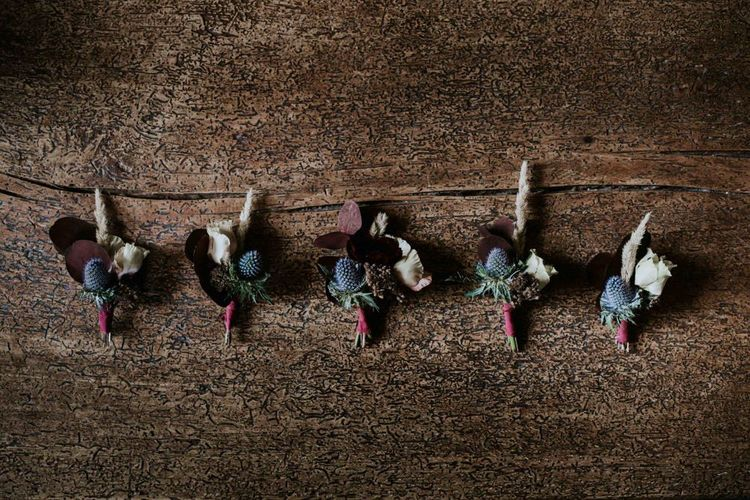 Buttonholes for groom at French wedding with perspex table plan