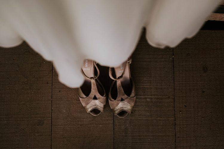 Velvet wedding shoes at French wedding with perspex table plan