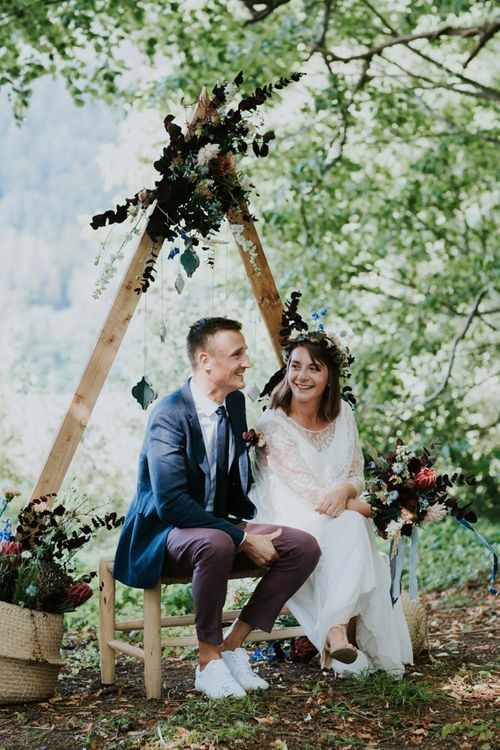 Bride and groom during woodland wedding ceremony