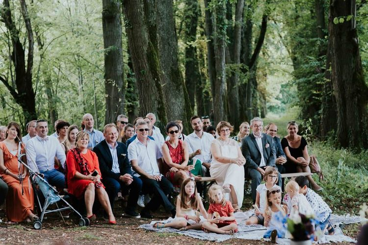 Guests watch the wedding ceremony in France