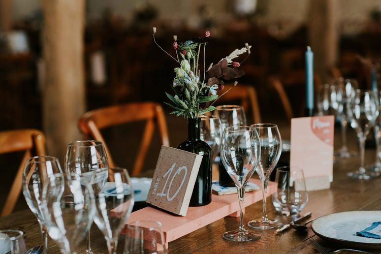 Table numbers with candles and flower table decor