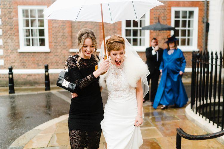 Bride in Lace San Patrick Wedding Dress | Bridesmaid in Black Dress | Candle Lit Christmas Wedding at Gray's Inn London with Christmas Carols & Festive Wreaths | John Barwood Photography