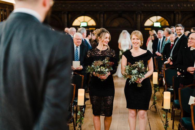 Wedding Ceremony | Bridesmaids in Black High Street Dresses | Candle Lit Christmas Wedding at Gray's Inn London with Christmas Carols & Festive Wreaths | John Barwood Photography