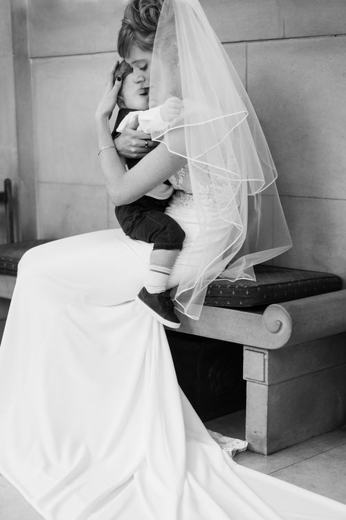 Bride in Lace San Patrick Gown and Son | Candle Lit Christmas Wedding at Gray's Inn London with Christmas Carols & Festive Wreaths | John Barwood Photography