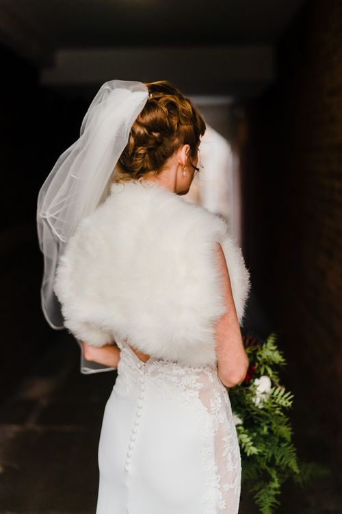 Bride in Lace San Patrick Gown & Fur Coverup | Candle Lit Christmas Wedding at Gray's Inn London with Christmas Carols & Festive Wreaths | John Barwood Photography