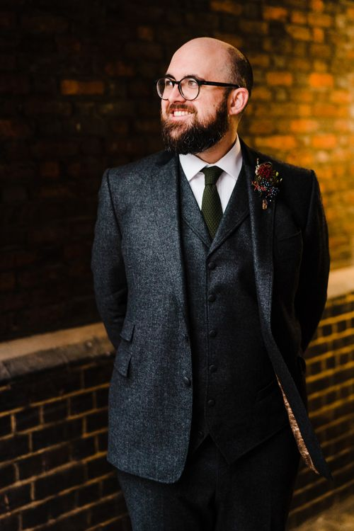 Groom in Tweed Chester Barrie Suit | Candle Lit Christmas Wedding at Gray's Inn London with Christmas Carols & Festive Wreaths | John Barwood Photography