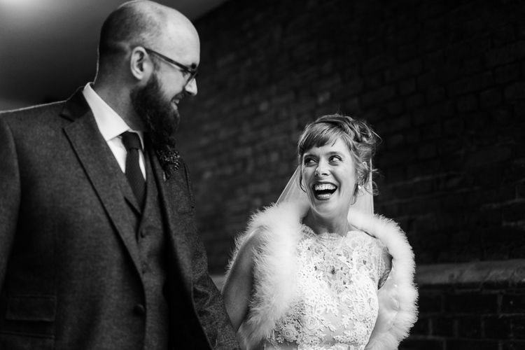 Bride in Lace San Patrick Gown & Fur Coverup | Groom in Tweed Chester Barrie Suit | Candle Lit Christmas Wedding at Gray's Inn London with Christmas Carols & Festive Wreaths | John Barwood Photography