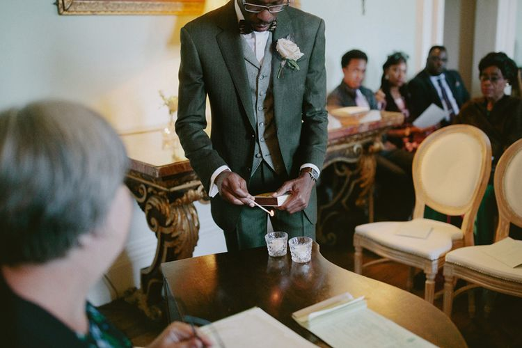 Groom lights candles and waits for bride at ceremony