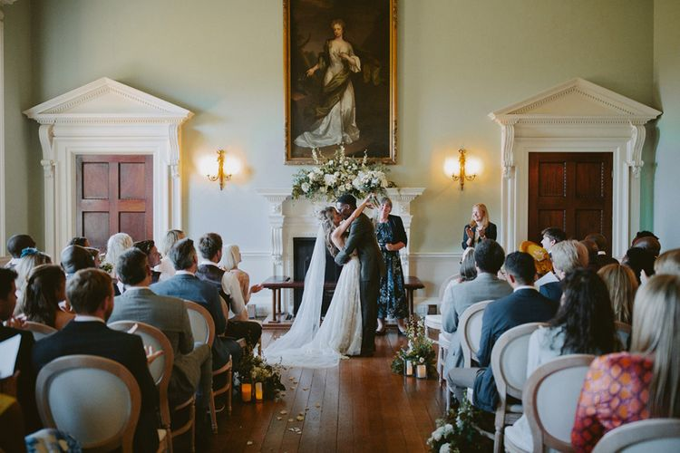 Bride and groom kiss at Kirtlington Park wedding ceremony