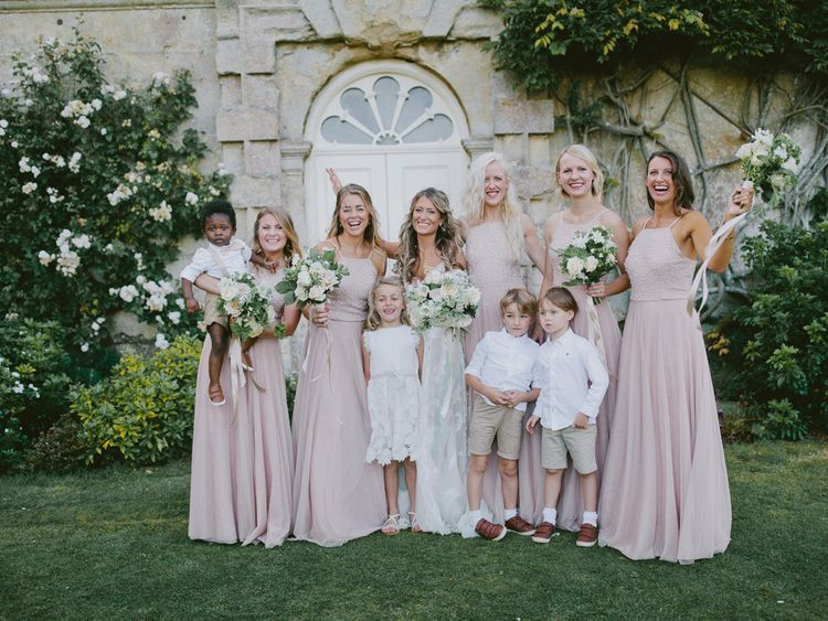 Pink bridesmaid dresses with page boys
