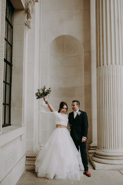 Bride in Sassi Holford; Tamara Top & Tulle Fearn Skirt and Groom in Cad in The Dandy Suit
