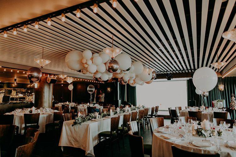 Wedding Reception with White and Silver Balloon Cloud Wedding Decor