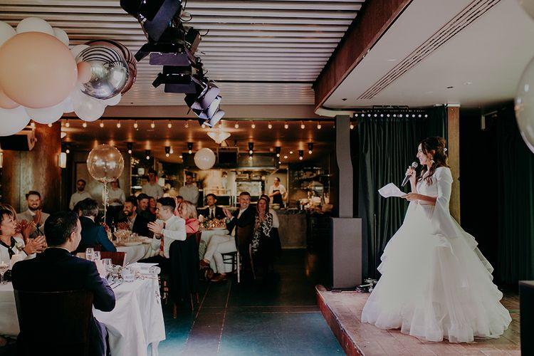 Bride in Sassi Holford; Tamara Top & Tulle Fearn Skirt Giving Wedding Speech