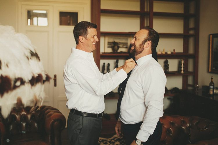 Groom gets ready for French wedding