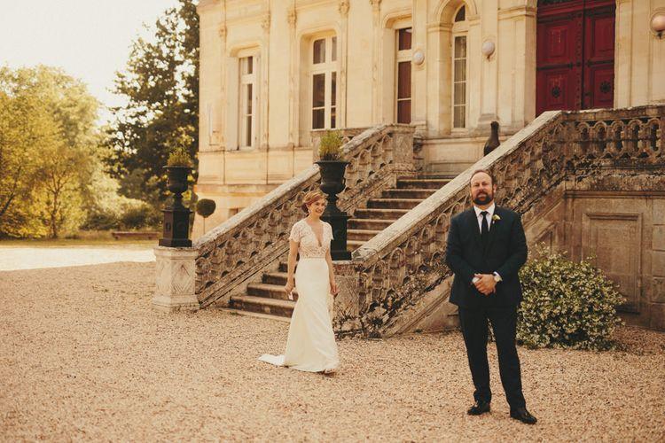 Bride in Sarah Severn wedding dress at First Look