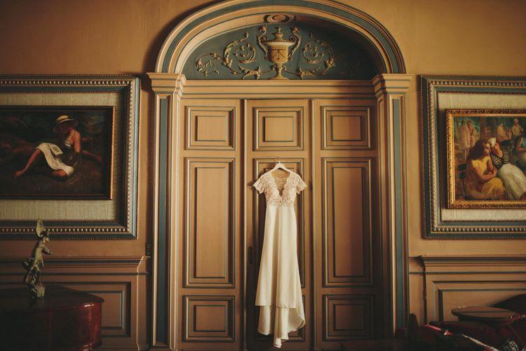 Sarah Seven wedding dress hanging at chateau wedding venue