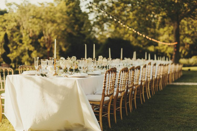 Simple white and gold decor for wedding breakfast in France