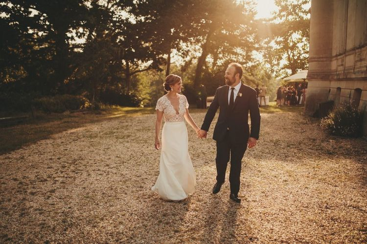 Bride in Sarah Seven wedding dress with groom