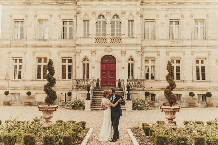 Bride in Sarah Seven wedding dress with groom at French wedding venue