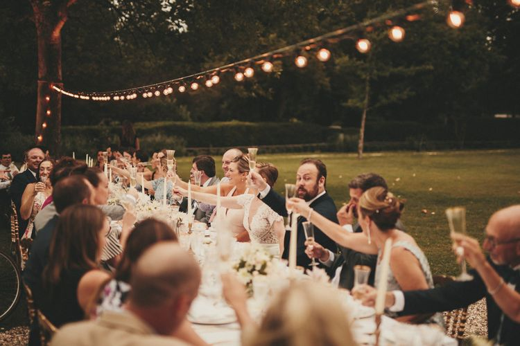 Wedding guests toast the special day