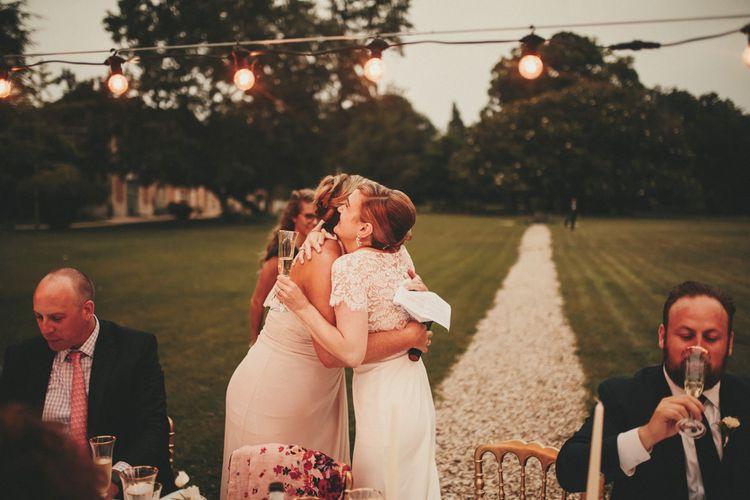 Bride hugs wedding guests