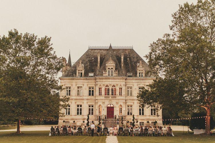 Wedding breakfast outside French chateau venue