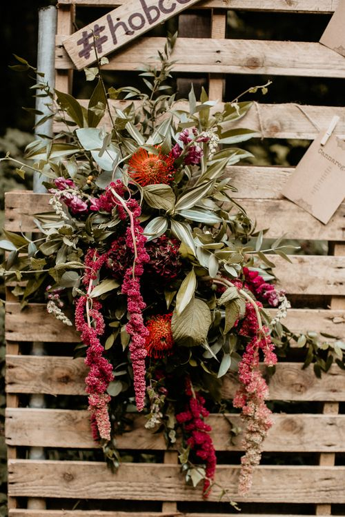 Red & Green Wedding Flowers | Burgundy Outdoor Woodland Ceremony & Country Tipi & Horse Bar Reception at The Ancient Woodland, Hertfordshire, Planned & Styled by Caroline Hitchcock Events | Alex Wysocki Photography | DgtlCouture Film