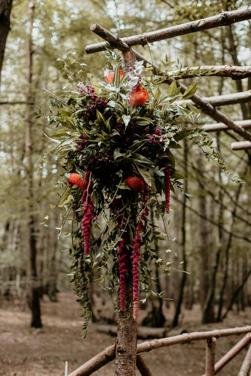 Pergola Wedding Flowers | Burgundy Outdoor Woodland Ceremony & Country Tipi & Horse Bar Reception at The Ancient Woodland, Hertfordshire, Planned & Styled by Caroline Hitchcock Events | Alex Wysocki Photography | DgtlCouture Film