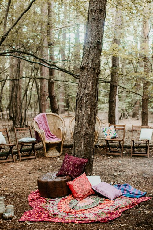 Peacock Chairs, Moroccan Rugs Seating Area | Burgundy Outdoor Woodland Ceremony & Country Tipi & Horse Bar Reception at The Ancient Woodland, Hertfordshire, Planned & Styled by Caroline Hitchcock Events | Alex Wysocki Photography | DgtlCouture Film